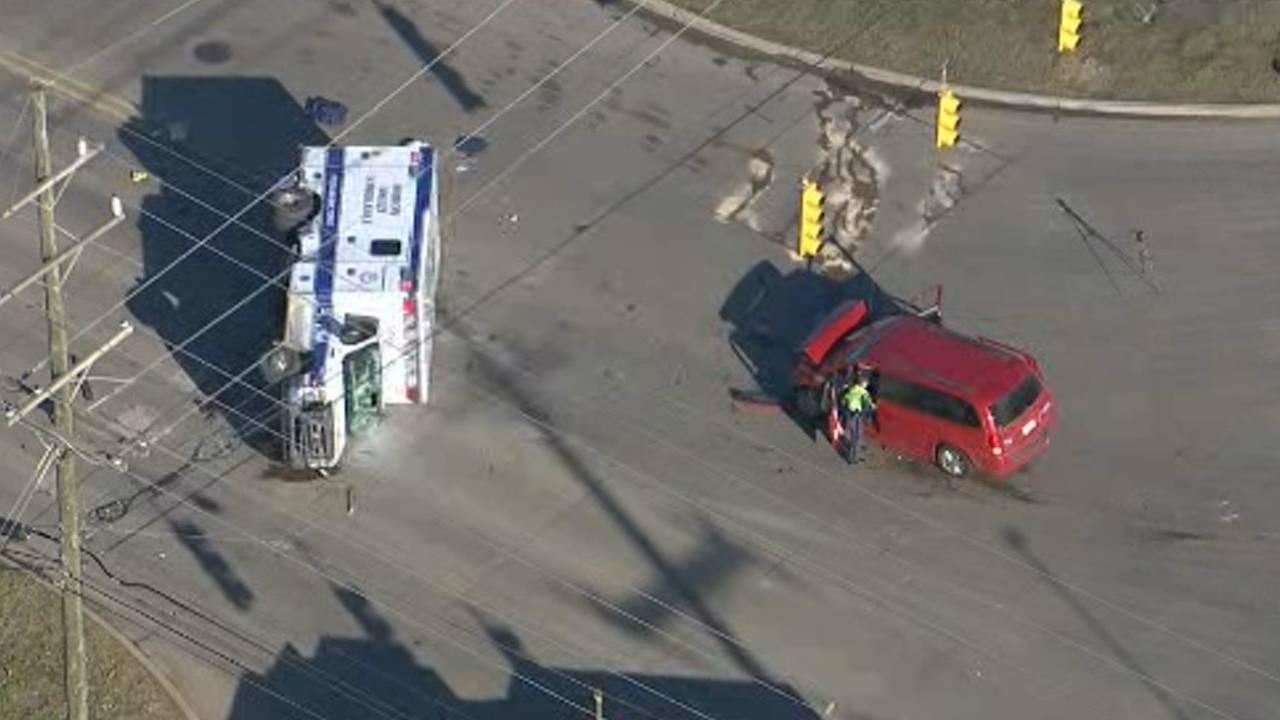 5 taken to hospital after crash causes ambulance to flip over