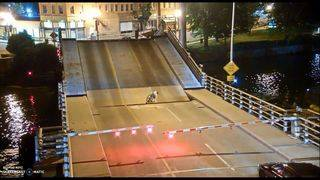 VIDEO: Bicyclist ignores safety signs, falls into draw bridge