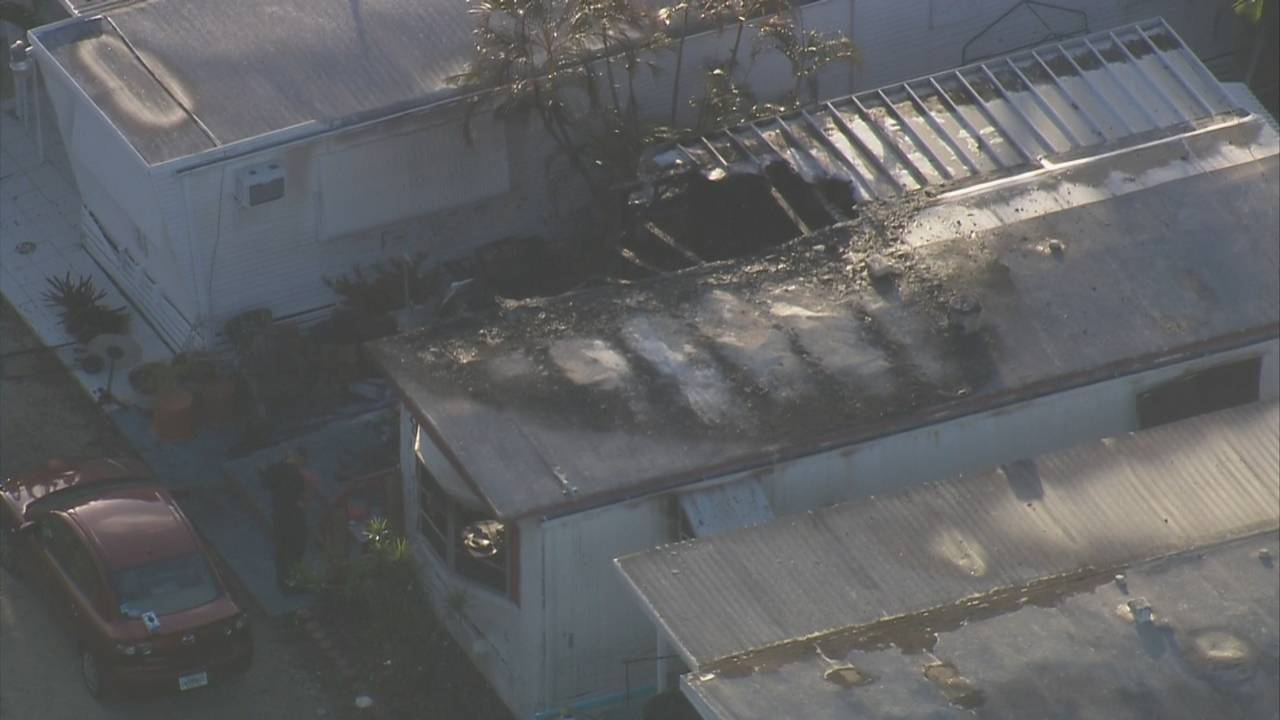 Sky 10 hole in roof of Hallandale Beach mobile home after fire