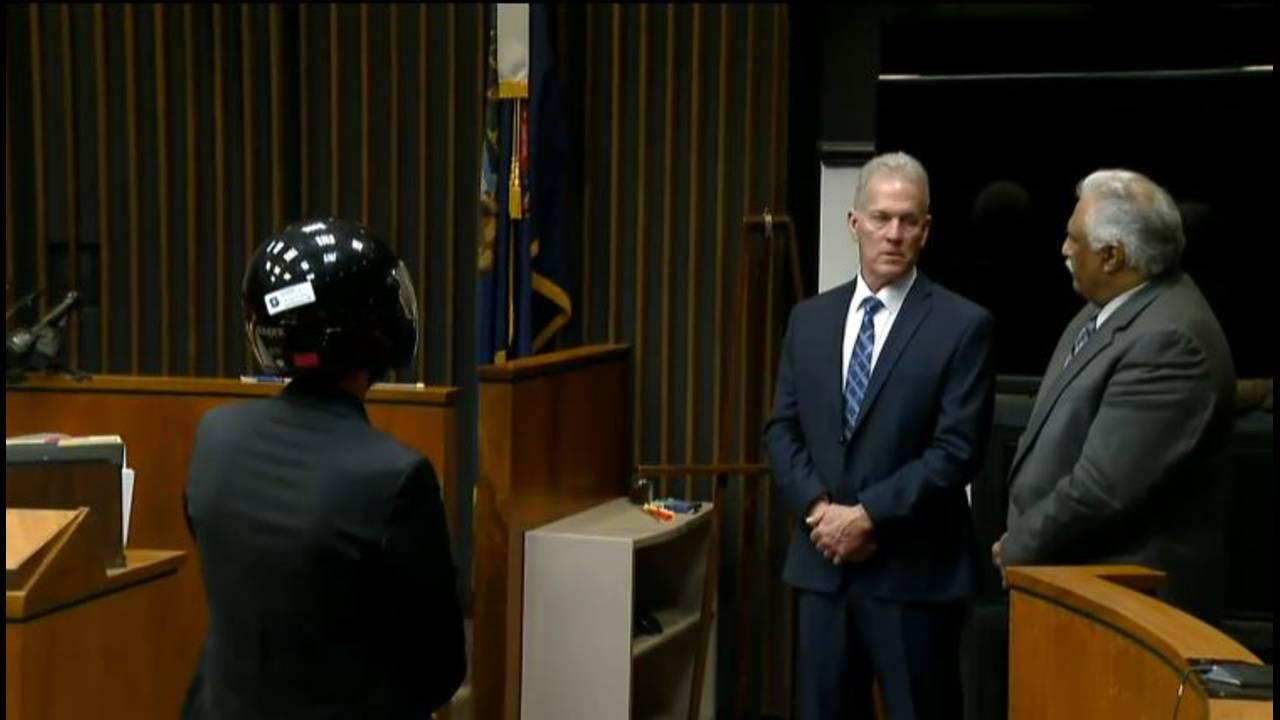 James VanCallis in court with helmet on