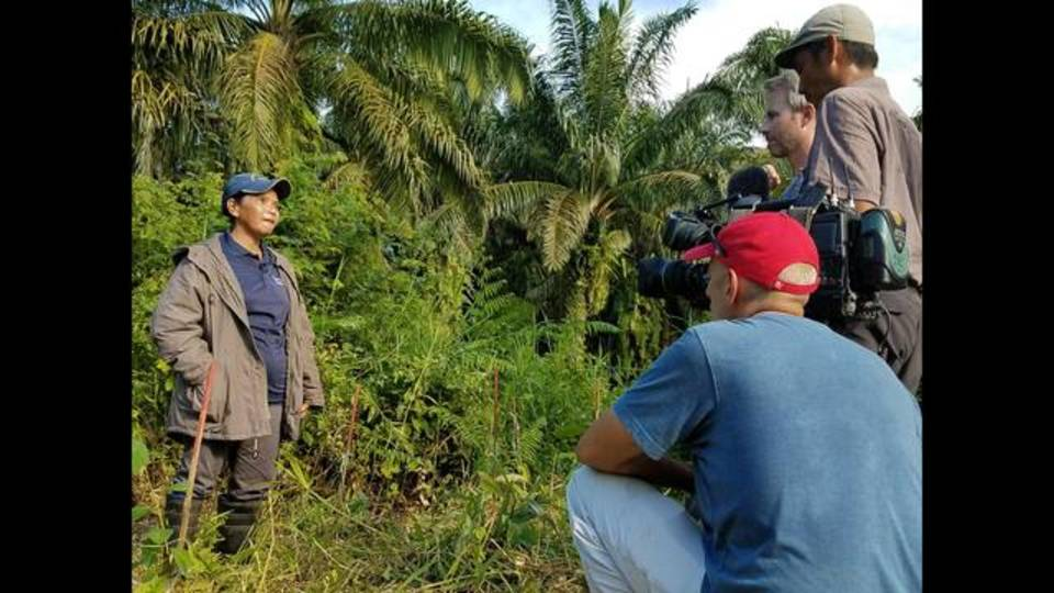 Justin interviewing a mother and grandmother about her work on a reforestation project_1512754414936.jpg