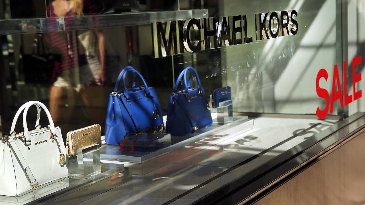 cfc922942abe Michael Kors is buying Versace for  2 billion