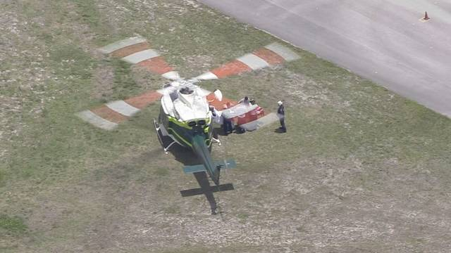 Shooting victim being placed into helicopter in Opa-locka