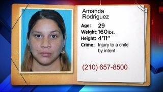 Converse woman wanted on charge she intentionally hurt child