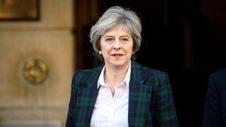 Theresa May stares down Brexit turmoil, vowing to see her deal through