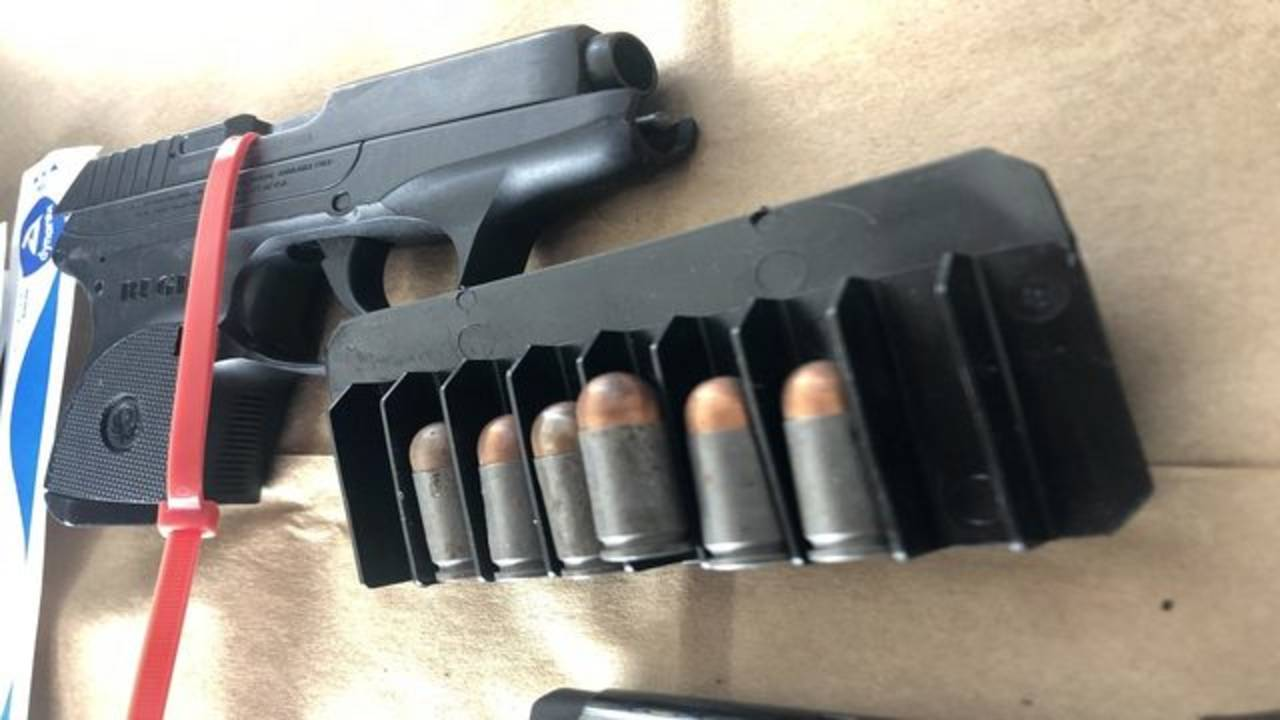 gun and ammunition confiscated from officer