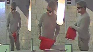 Bank robber whispers to clerk, 'This is a robbery'