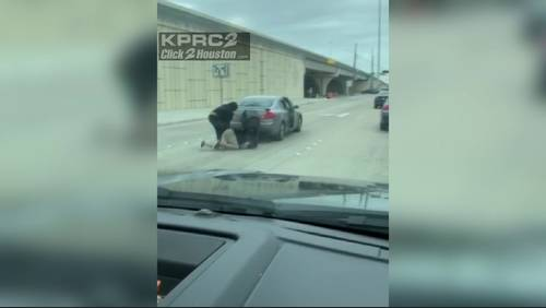 Woman records men fighting in middle of NW Houston street