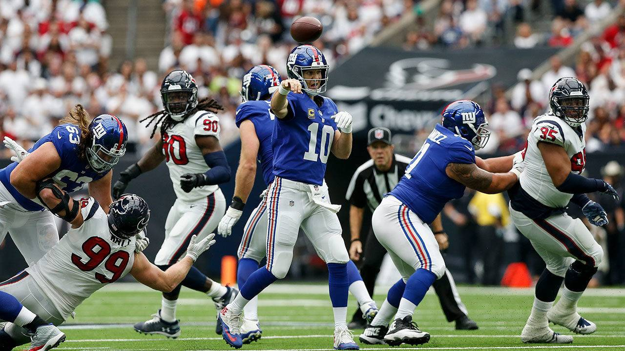 4fc080135 Manning throws 2 TDs as Giants beat Texans 27-22 for 1st win