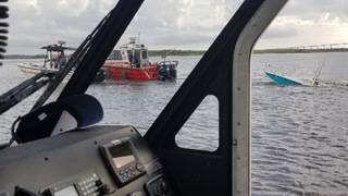 Coast Guard: 3 rescued after boat capsizes near Blount Island