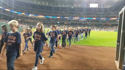 School celebrates milestone after Harvey by singing National Anthem at Astros game