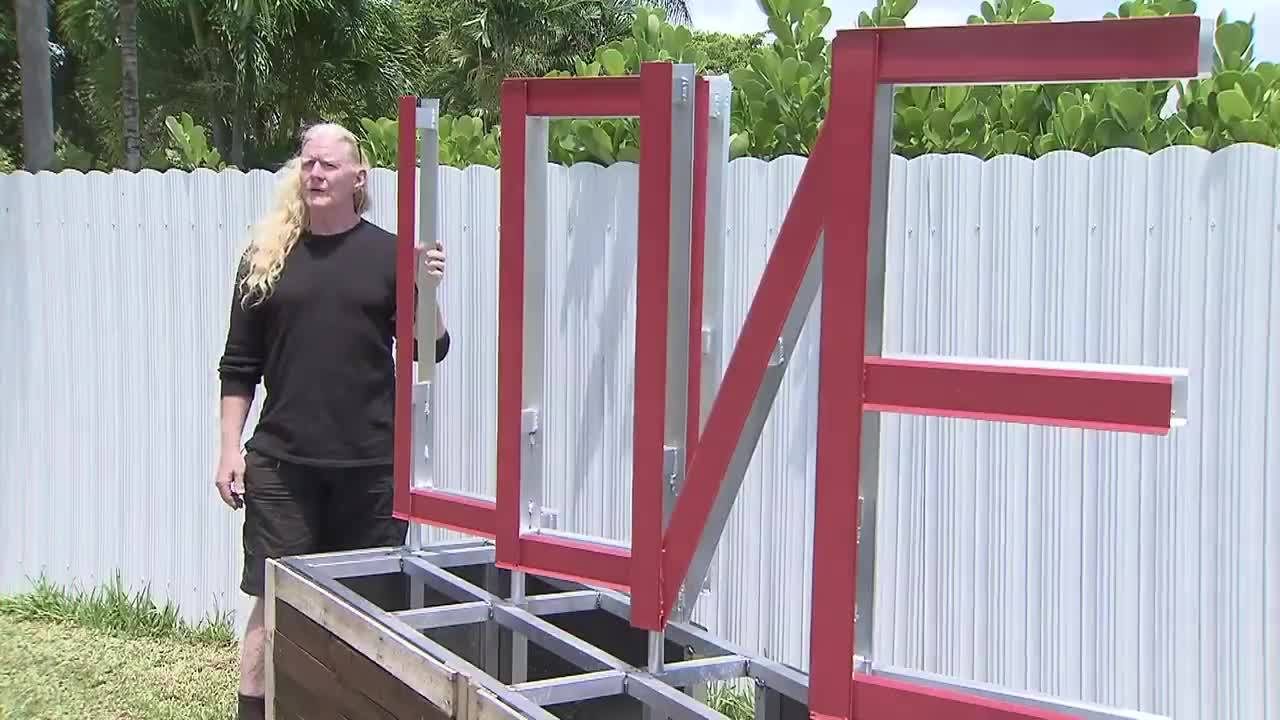 Mickey Munday stands next to 'Love' sign at park