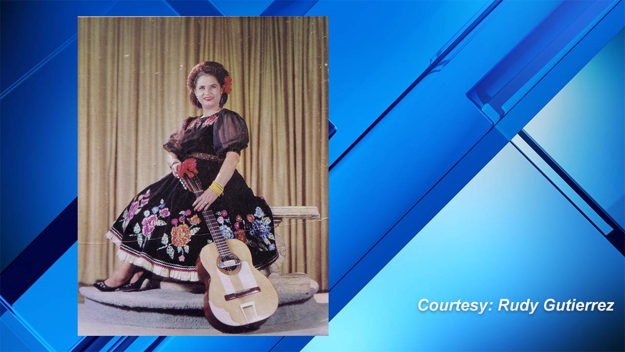 Lydia Mendoza sitting with guitar