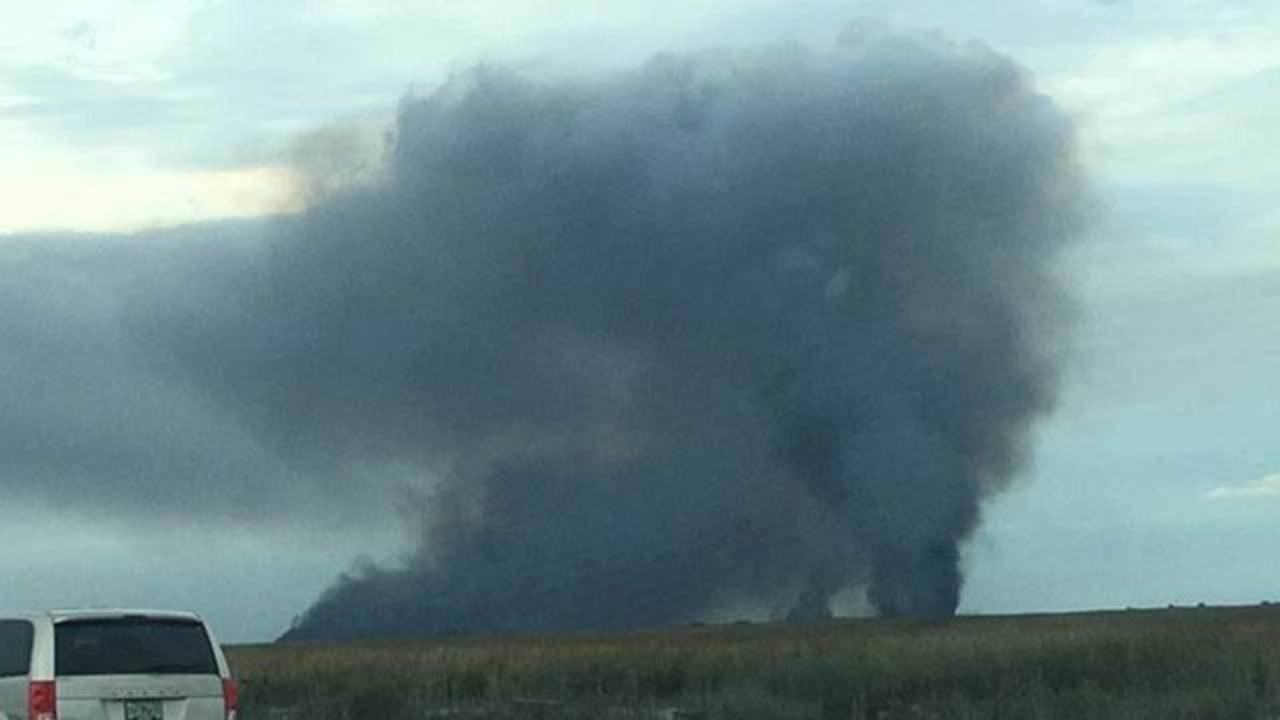 Dark smoke visible