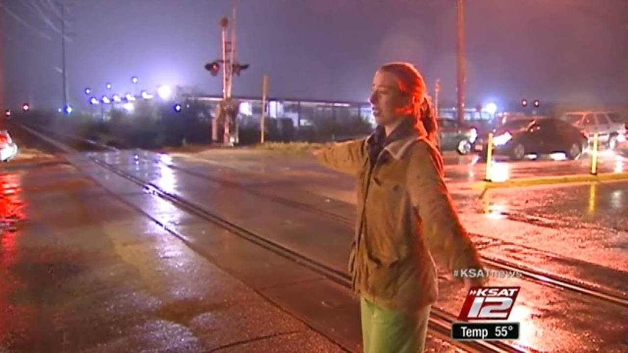 Drivers direct traffic after railroad crossing guards