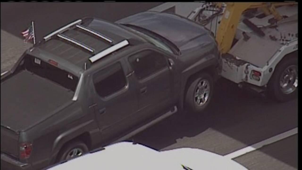 Zimmerman's truck damaged_32944760
