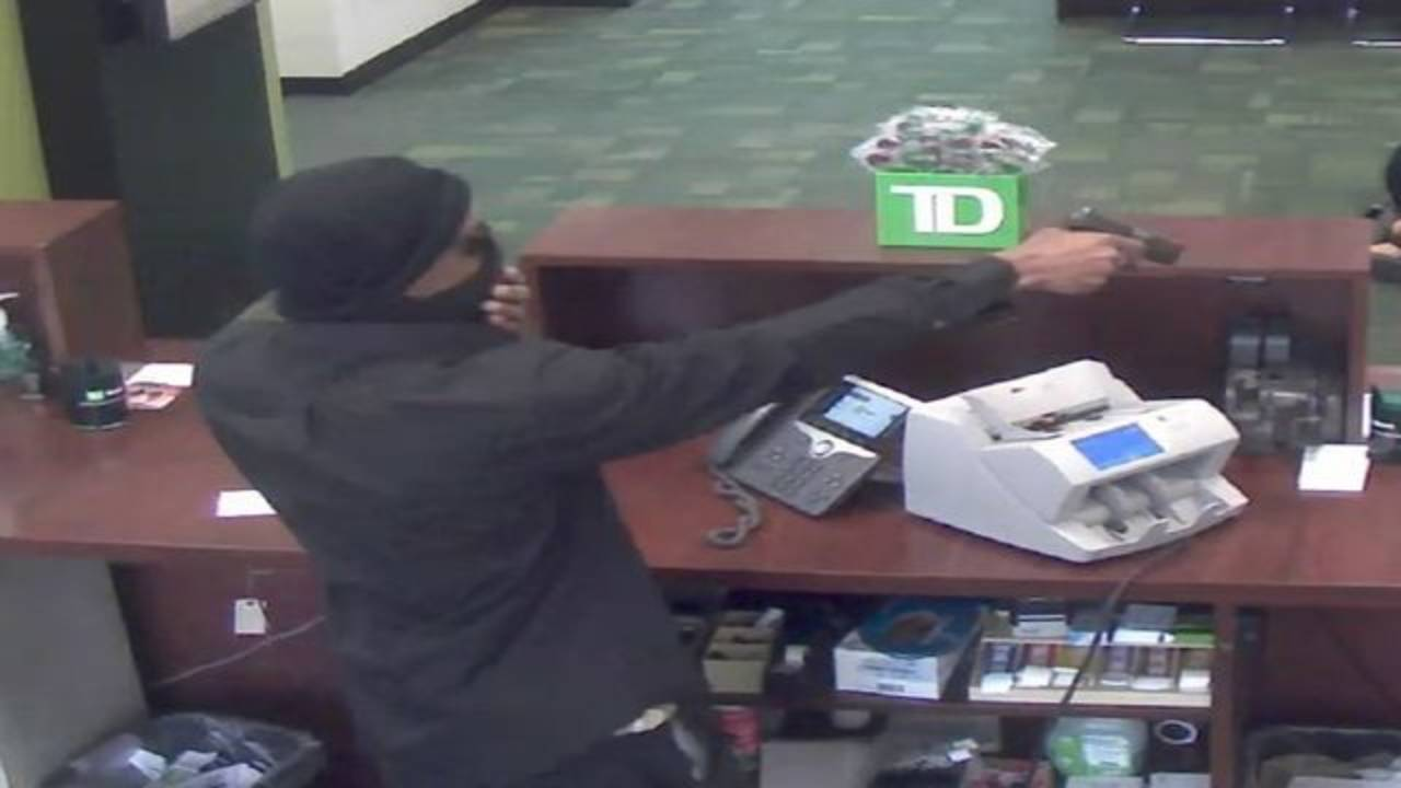TD Bank robber behind counter