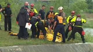 Woman swept underground by rushing waters rescued from Woodlawn Lake