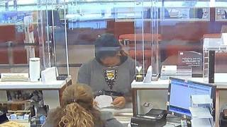 Woman hands note to teller demanding cash at Wells Fargo in Plantation