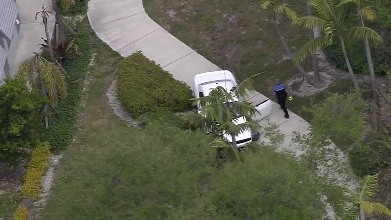 crashed dodge challenger after police chase