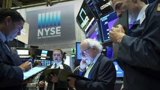 Dow slides on trade war worries