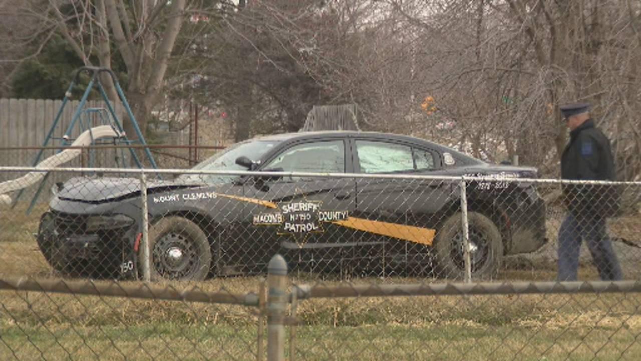 Macomb County Sheriff's Office car crashes into backyard