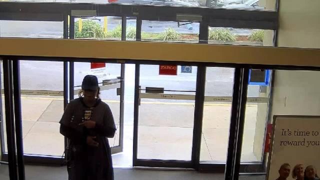 Female bank robber entering Wells Fargo
