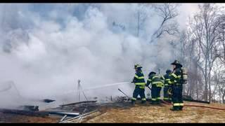 Crews struggled to get to fire that burned house to the ground