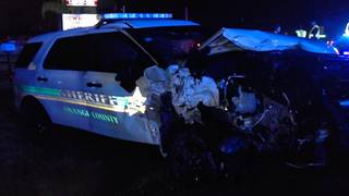 PHOTOS: Man plows into Orange County deputy's car on side of road, FHP says