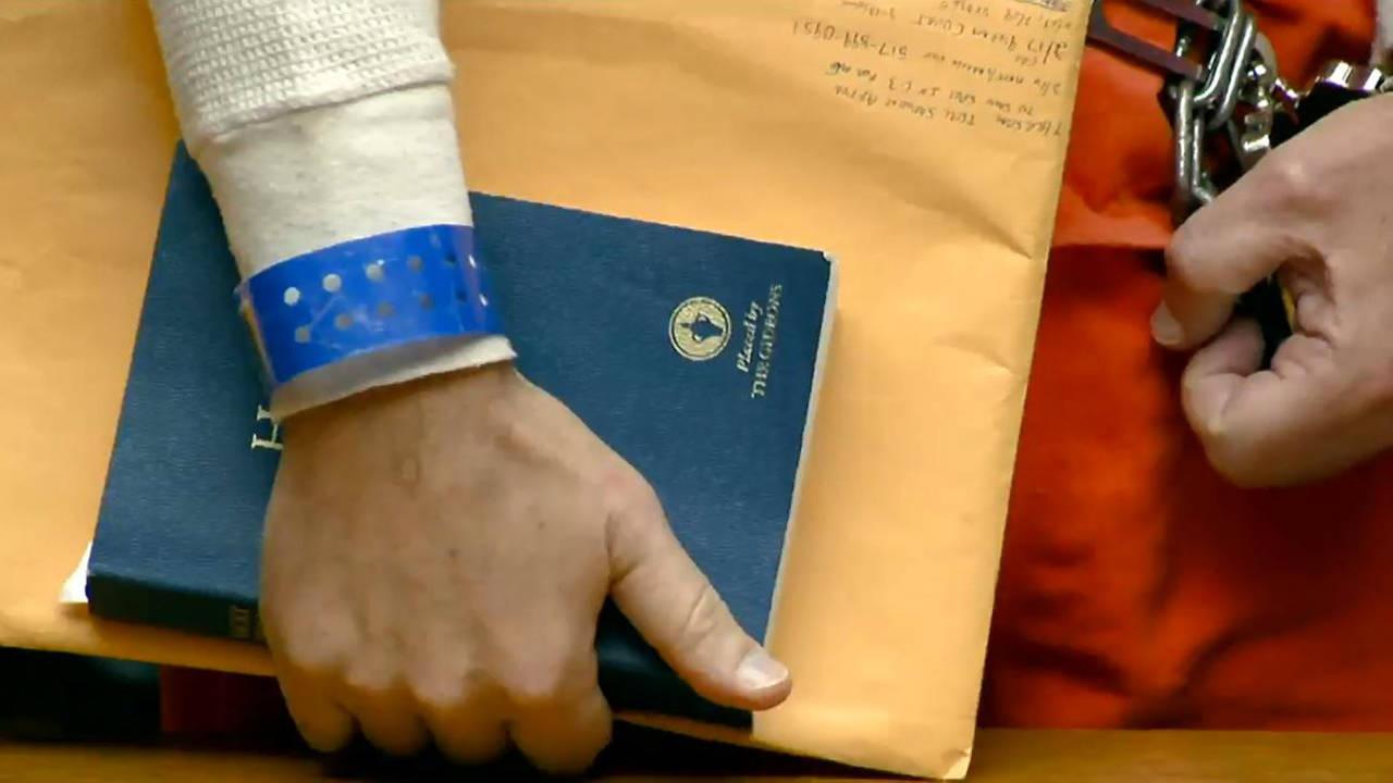 Nassar holding Bible_1487863245562.jpg
