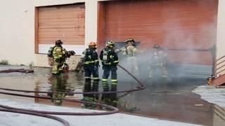 Dump truck, warehouse catch fire near Hialeah, authorities say
