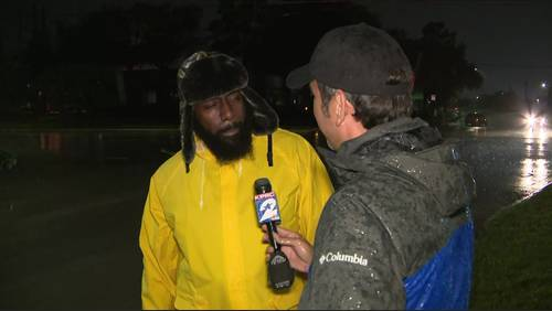 'I gotta represent': Trae Tha Truth works to help stranded motorists during heavy storms