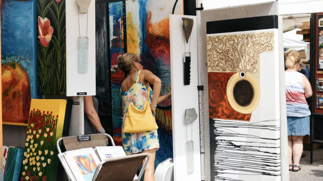 Woman looks at art Ann Arbor Art Fair