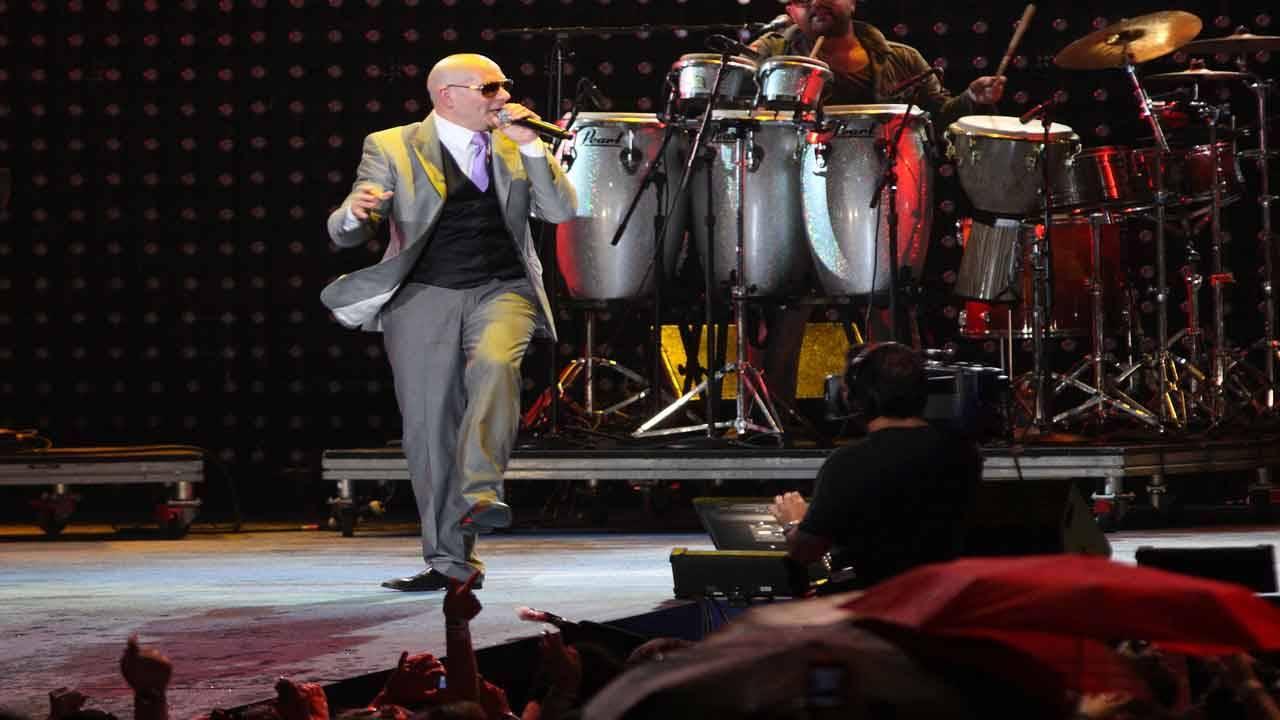 Pitbull performs at Super Bowl XLIV fan jam in 2010