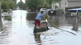 Crews work around-the-clock to clear flooded streets