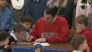 Wisconsin governor signs child tax rebate, sales tax holiday
