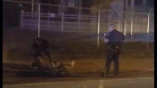 New video shows man helping officer make arrest