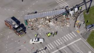 Semi-truck spills load at busy intersection in Deerfield Beach