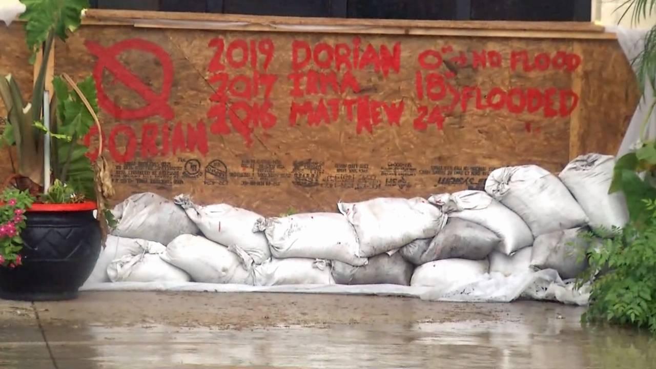 09-04 Davis Shores sandbags and Matthew, Irma, Dorian sign