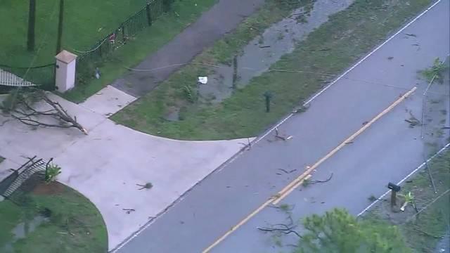 broken fences and debris in road near Loxahatchee