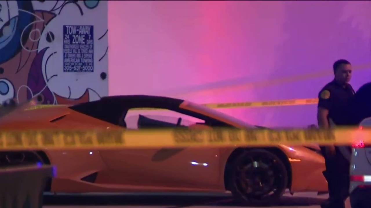 yellow Lamborghini parked outside building where stabbing occurred