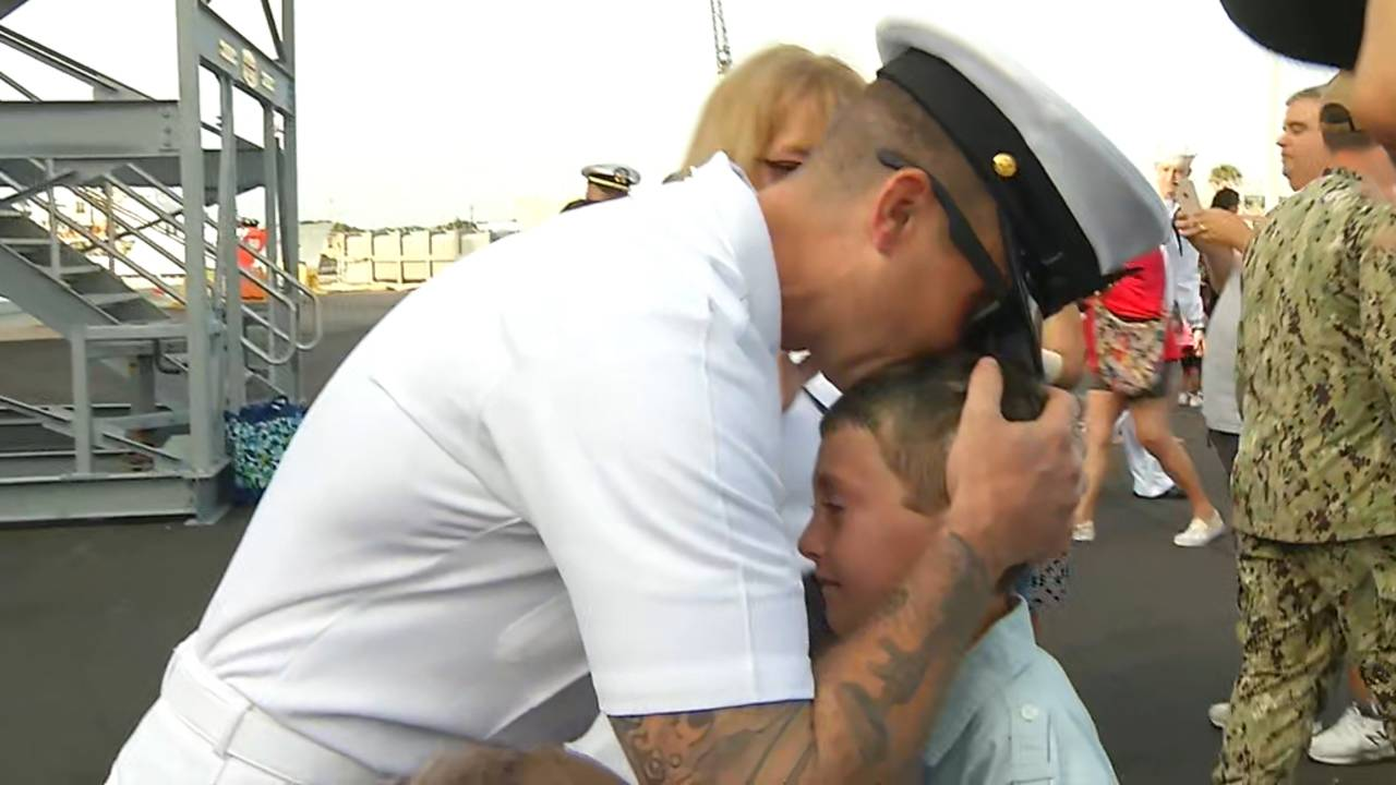USS Fort McHenry Sailor-with-son_1563452925510.jpg