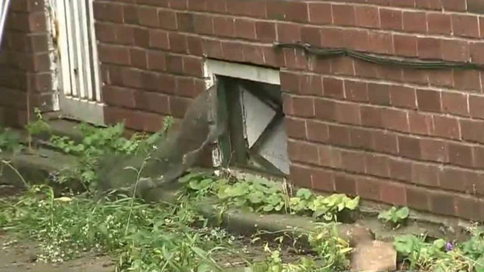 Man breaks into own home gets trapped in window