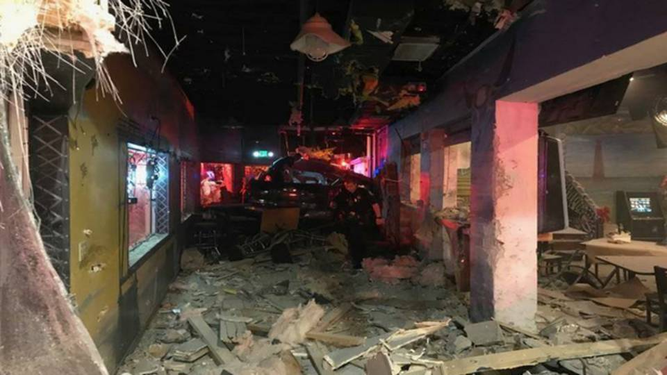 Pickup truck crashes into Overseas Liquors interior