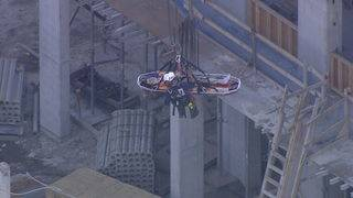 Crane used to bring down worker who injured back on 5th floor of building