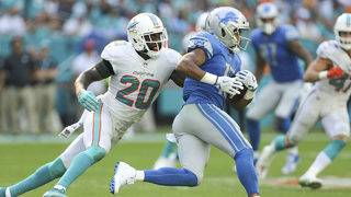 Safety Jones misses Dolphins' 1st practice under Flores