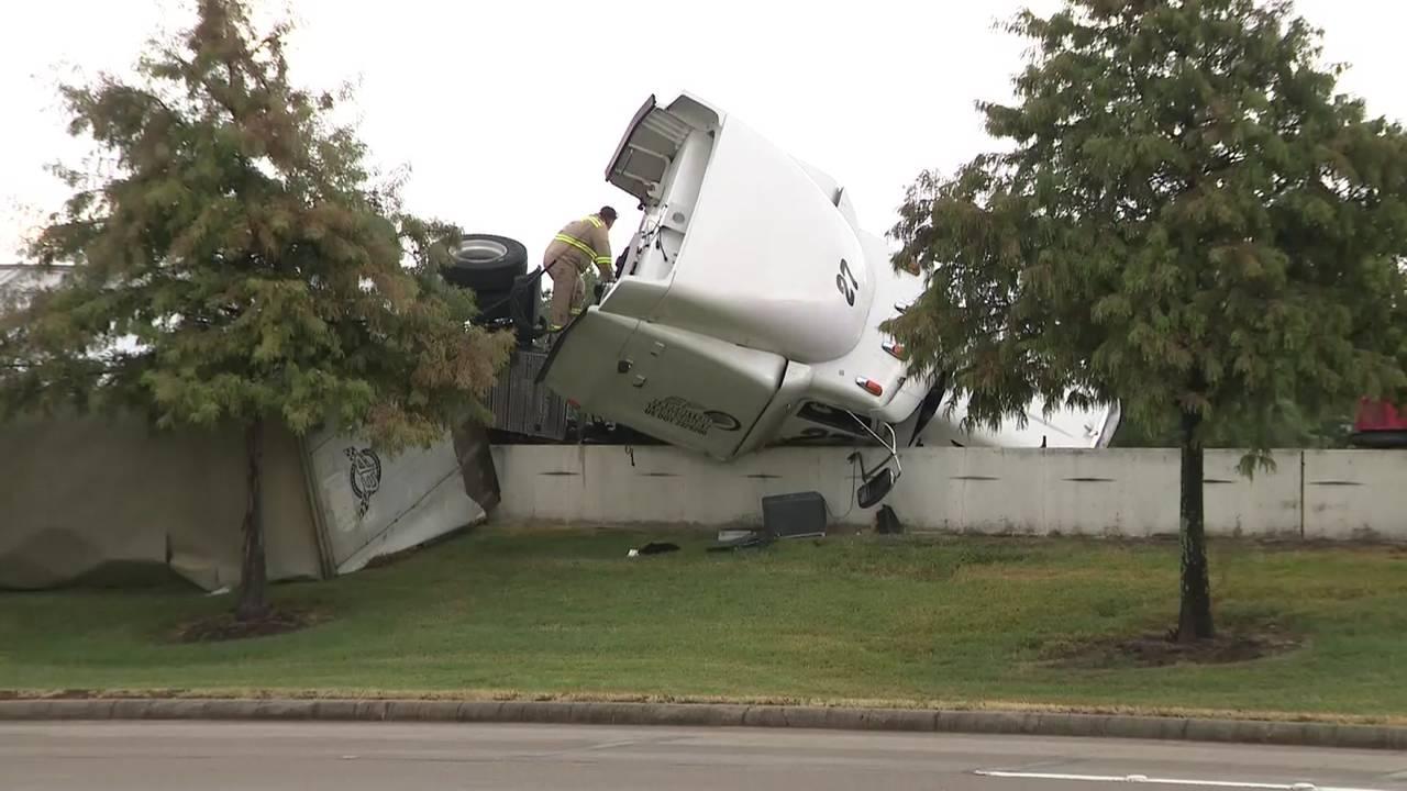 59 crash over barrier