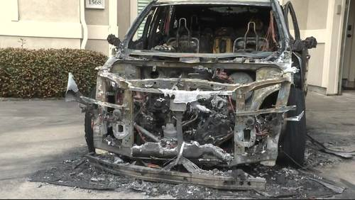 Family escapes burning SUV in driveway